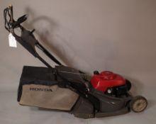 A Honda HRX 476 garden lawn mower.