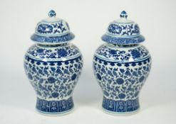 A pair of modern Chinese style blue and white porcelain vases and covers,