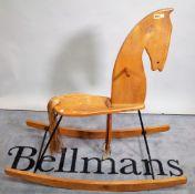 A 20th century elm rocking horse, 113cm wide x 109cm high.