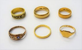 Two 22ct gold wedding rings, combined weight 7 gms, two 18ct gold rings, combined weight 11.