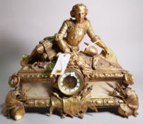 An early 20th century gilt brass mantel clock with finial formed as recumbent knight,