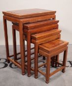A 20th century hardwood Chinese nest of four tables, the largest 50cm wide x 66cm high.