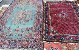 A Saraband rug, Persian, the madder field with rows of boteh,