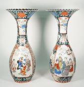 A pair of tall Japanese Imari slender baluster vases, Meiji period,