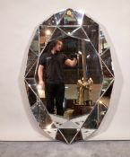A modern oval geometric pattern mirror, 80cm wide x 120cm high.