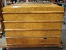 A modern burr walnut and brass bound lift top TV stand with single drawer to base,