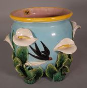 A Victorian style ceramic jardiniere with moulded floral decoration, 23cm wide x 27cm high.