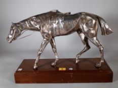 An early 20th century silver plated model of a horse on a oak rectangular plinth base,