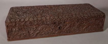 A 19th century Anglo Indian carved sandalwood jewellery box, 29cm wide x 7cm high.