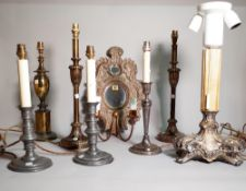 A group of seven assorted decorative table lamps including silver plated and pewter examples and a