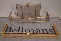 A late Victorian brass serpentine fire fender, 114cm wide x 17cm high, another later brass fender,