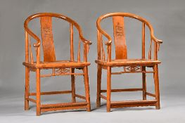A pair of early 20th century Chinese huanghuali horseshoe back armchairs, with solid seats,