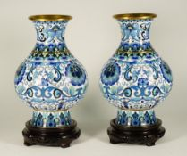 A pair of Chinese cloisonné pear shaped vases,