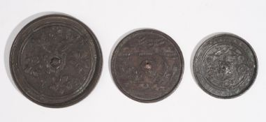 Three metal alloy circular mirrors, probably Japanese, late 19th/20th century,