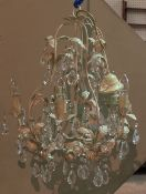 A 20th century white painted metal open frame chandelier with glass drop decoration, 60cm high.