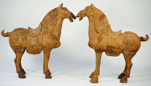 A pair of modern Chinese style Tang horses with rustic patina, 65cm high, (2).