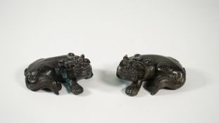 A pair of Chinese bronze figures of Buddhist lions, 19th century,