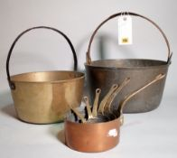 A quantity of early 20th century copper pots and pans, the largest 38cm wide, (qty).