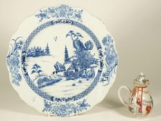 A Chinese blue and white export dish, Qianlong, painted with two figures in a river landscape,