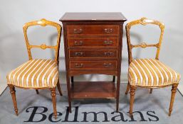 An Edwardian inlaid mahogany four drawer folio stand,
