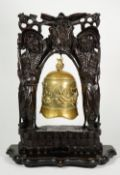 A Chinese bronze bell, early 20th century, cast with a dragon chasing a flaming pearl,