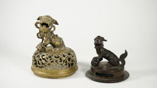 A Chinese bronze cover, Ming dynasty, 17th century, surmounted by a Buddhist lion,
