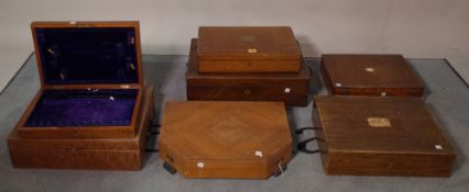 A group of seven mahogany/ oak cutlery boxes of various sizes, the largest 49cm wide x 14cm high,