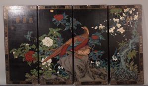 Four Chinese lacquer rectangular hanging panels, decorated with birds amongst flowering shrubs,