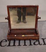 A William IV walnut two drawer toilet mirror on bun feet, 54cm wide x 61cm high.