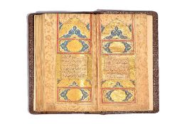 A Qur'an, illuminated Arabic manuscript in naskhi script on gold-sprinkled paper,
