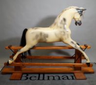 'Haddon Rockers', a 20th century fibreglass rocking horse, on a pine frame, 170cm wide x 130cm high.