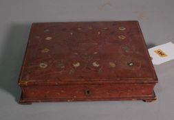 An early 20th century French embossed red leather stationery cum writing box.
