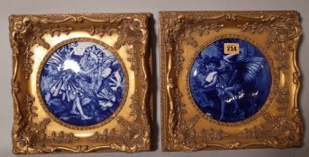 A pair of blue and white ceramic panels, depicting flower faries, each panel 17cm diameter.