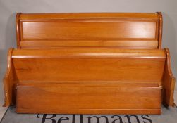 A 20th century cherrywood superking sleigh bed, 192cm wide x 109cm high.