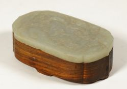 A Chinese hardwood box with jade cover, late 19th/20th century, of shaped oblong form,