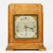 An Edwardian leather desk timepiece retailed by the Goldsmiths & Silversmiths, London, by Elliott,