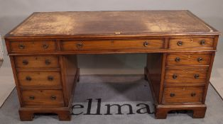 A 19th century mahogany pedestal desk with nine drawers about the knee, on bracket feet,