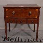 A George III inlaid mahogany rectangular writing desk, the fitted drawer over three short drawers,
