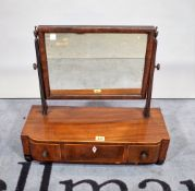 An early 19th century mahogany toilet mirror, with a bow three drawer base, 55cm wide x 50cm high.