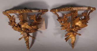 A pair of Victorian style serpentine gilt wood wall shelves, 28cm wide x 30cm high, (2) (a.f.).