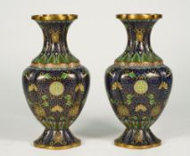 A pair of Chinese cloisonné vases, circa 1900, of quatrelobed baluster form,