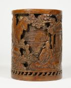 A Chinese bronze double-walled cylindrical brush pot, sixteen character Xuande mark but later,