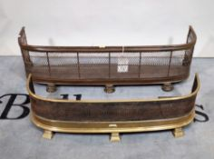Two early 20th century brass and metal mesh fire fenders,