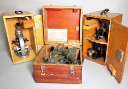 'MCN', a 20th century cased Sexton, 29cm wide x 20cm high and two cased 20th century microscopes,