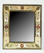 A 19th century rectangular wall mirror with a wide gilt foliate decorated border, 38cm x 33cm.
