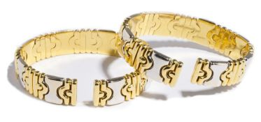 A pair of Italian two colour gold and diamond set sprung bangles,