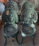 A matched set of four 20th century green painted metal garden chairs, 36cm wide x 82cm high, (4).