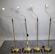 A group of four 20th century brass floor standing angle poise lamps, each 148cm high, (4).