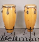 Two similar bongo type drums on stands, (2).