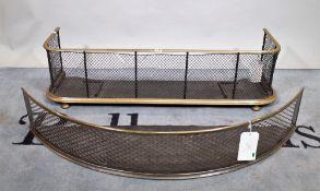 An early 20th century brass and mesh fire fender on bun feet,